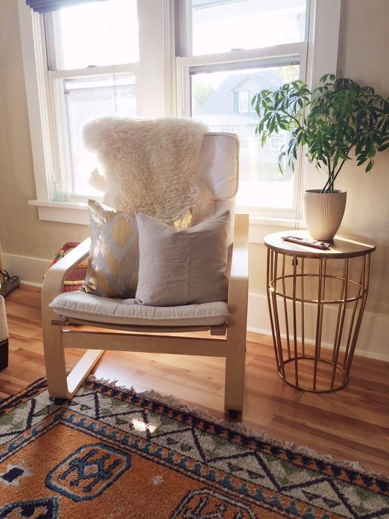 ikea poang chair with pillows and a fur cover for a living room