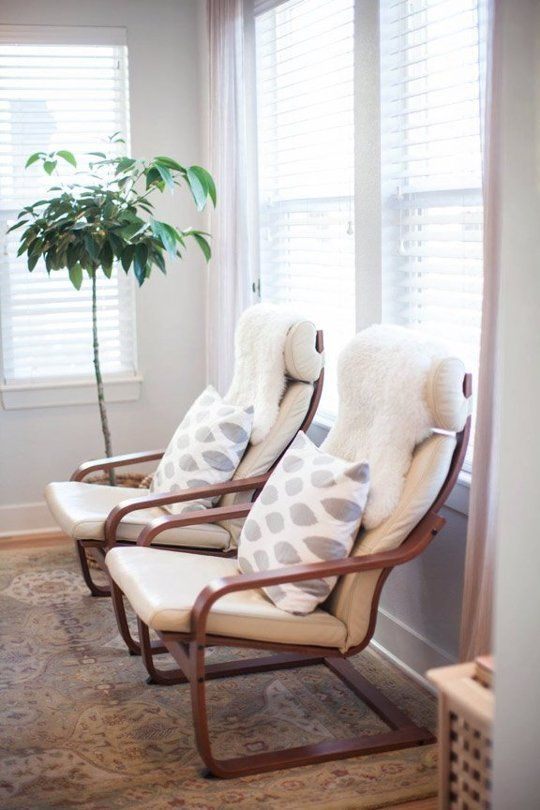 white ikea poang chair with printed cushions and fur covers