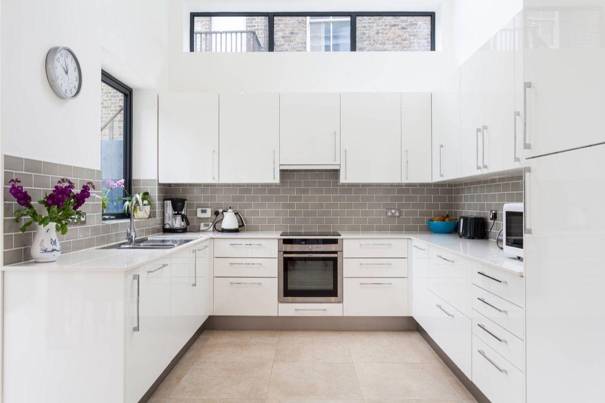 grey and white kitchen White Kitchen Cream Tile Floors 26