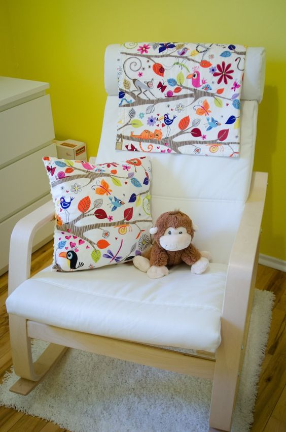 ikea poang chair with a floral pillow and cover